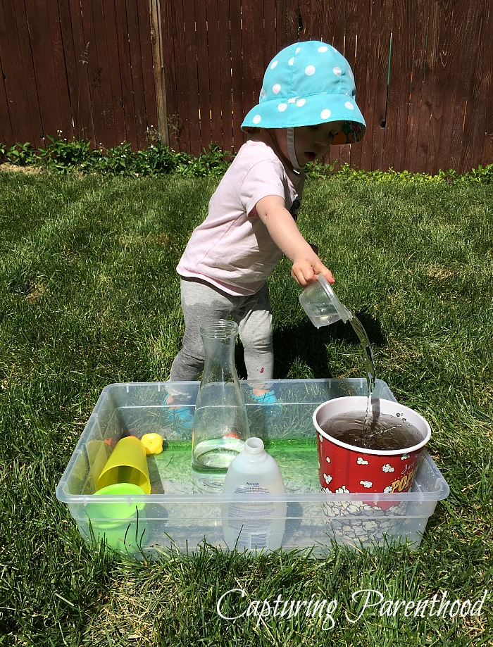 Pouring Station - The Perfect Summer Activity for Toddlers © Capturing Parenthood